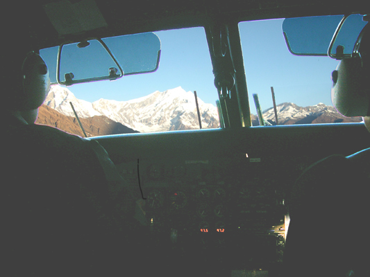 View of Himalayas from the cockpit of airplane. Our plane flies to Jomsom