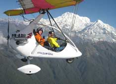 Extreme flights. Hang glider over the Himalayas in Nepal